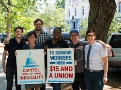 Stephanie Ainbinder, Sarah David Heydemann and Mitchell West join other SEIU law clerks for the Good Jobs Nation action in Washington, DC.